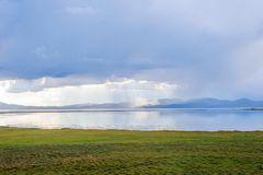 Storm over Song Kul lake. Storm cloud over Song Kul lake, Kyrgyzstan Stock Images