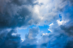 Storm cloud, rain cloud with blue sky Stock Image