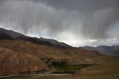 Storm cloud and rain clouds over the mountains, Tien-Shan, Stock Photo