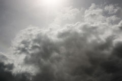 Storm cloud and sun in the sky Stock Photo