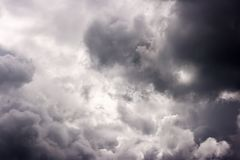 Storm cloud on sunny day. Light in the dark and dramatic storm clouds. background of storm clouds before a thunderstorm royalty free stock image