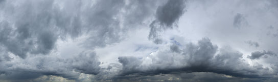Storm clouds. Panorama of heavy, dark storm clouds Stock Images
