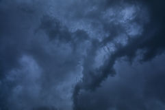 Storm Clouds. Dark swirling thunder storm clouds Royalty Free Stock Image
