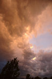 Storm Clouds. Orange Storm Clouds royalty free stock image