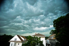 Storm Clouds. Some ominous storm clouds in the sky over houses in a neighborhood royalty free stock photos