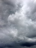 Storm clouds. Dark ominous grey storm clouds. Dramatic sky royalty free stock image