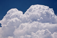 Storm Clouds. Gathering against a blue sky Stock Images