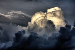 Storm clouds. Heavy storm clouds illuminate from sun Stock Photos