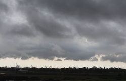 Storm clouds above the village Stock Photography