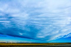 Storm clouds across the prairies. Spreading wide, Vulcan County, Alberta, Canada Stock Photos