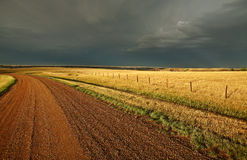 Storm clouds along a Saskatchewan road Royalty Free Stock Images