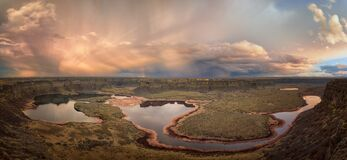 Free Storm Clouds And Rainbow Over Dry Falls Lake Panorama  Grant County Perch Lake Rainbow Lake Near Coulee City And Basalt Cliffs Stock Photos - 217230913