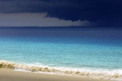Storm clouds approaching tropical white sand beach Stock Images