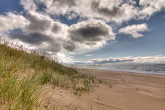 Storm Clouds at the Beach. Lake Michigan with storm clouds rolling in Stock Image