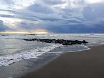 Storm clouds on blue sea. Storm clouds at sunset on the rough sea during autumn, Lido di Ostia, Rome, Italy Royalty Free Stock Photography
