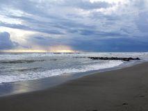 Storm clouds on blue sea. Storm clouds at sunset on the rough sea during autumn, Lido di Ostia, Rome, Italy Stock Photography