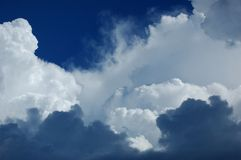 Storm clouds. And blue sky before the rain Royalty Free Stock Images