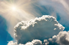 Storm Clouds in the blue sky and sun, background Royalty Free Stock Photo