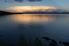 Storm Clouds Brew Over Yellowstone Lake Absaroka Mountains. A large cloud mushrooms out over the mountains surrounding Yellowstone Lake Royalty Free Stock Photography