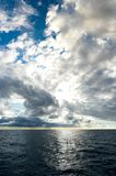 Storm clouds building up over dark blue ocean stock photos