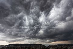 Storm clouds with contrast that threaten a heavy rain. Storm clouds with contrast between dark gray and white that threaten a heavy rain Stock Image