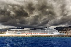 Storm clouds cruise ship Funchal. Beautiful view of the harbor of Funchal, Madeira, seen from the Atlantic ocean, with ominous clouds and a cruise ship stock photography