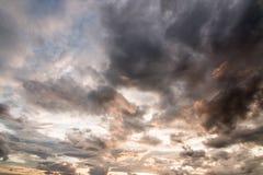 Storm clouds. Dark ominous grey storm clouds. Dramatic sky stock image