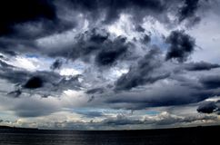 Storm clouds. Dark storm clouds over the sea Royalty Free Stock Image