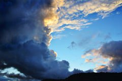 Storm clouds. Dramatic, dark storm clouds on the sky at sunset stock image