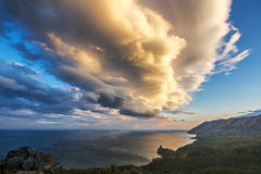 Storm clouds float over Baikal lake Royalty Free Stock Photo