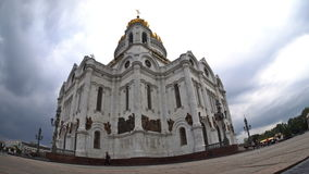The storm clouds floating over the Cathedral of Christ the Saviour. Fisheye. Time-lapse. UHD - 4K. August 30, 2016. Moscow. Russia stock video footage