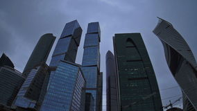 The storm clouds floating over the skyscrapers of the Moscow International Business Center. Fisheye. Time-lapse. UHD - 4K stock video footage