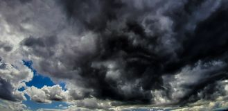 Storm clouds are formed from Cumulus clouds. Storm clouds formed cumulus first pass stage maturity development which decay precipitation accompanied electrical royalty free stock photography