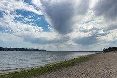 Storm clouds forming over a pacific northwest beach. Pacific northwest beach with clouds forming overhead Royalty Free Stock Images