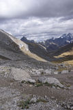 Storm clouds gather over broad glacial valley Stock Images
