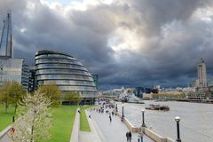 Storm clouds gather over City Hall, London, UK Stock Photo