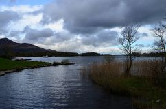 Storm Clouds Gathering Over the Lake in Killarney National Park. Gray storm clouds gathering over a lake in Killarney Naitonal Park Ireland royalty free stock image