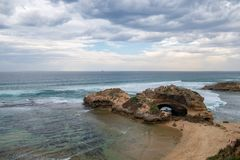 Storm clouds gathering over London Bridge at Portsea, Victoria, royalty free stock images