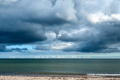 Storm clouds gathering over the ocean Stock Photography
