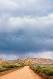 Storm clouds and gravel road in southern Utah Stock Photos