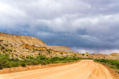 Storm clouds and gravel road in southern Utah Royalty Free Stock Photo