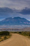 Storm clouds and gravel road in southern Utah Royalty Free Stock Photos