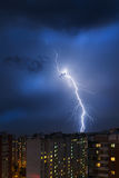 Storm clouds, heavy rain. Thunderstorm and lightning over the city. Royalty Free Stock Photo