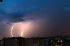 Storm clouds, heavy rain. Thunderstorm and lightning over the city. Royalty Free Stock Images