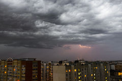 Storm clouds, heavy rain. Thunderstorm and lightning over the city. Night Scene Royalty Free Stock Photo