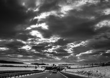 Storm Clouds And Highway Stock Images