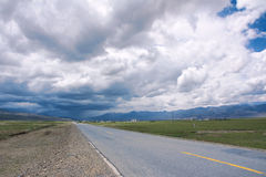 Storm clouds and highway Royalty Free Stock Image