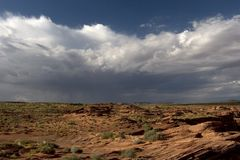 Storm Clouds, Horseshoe Bend. Storm clouds start to form over the barren landscape near Horseshoe Bend.  Page Arizona Stock Photo