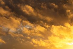 Storm clouds illuminated by the sunset sun. Free space royalty free stock photo