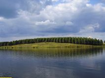 Storm clouds on lake royalty free stock image